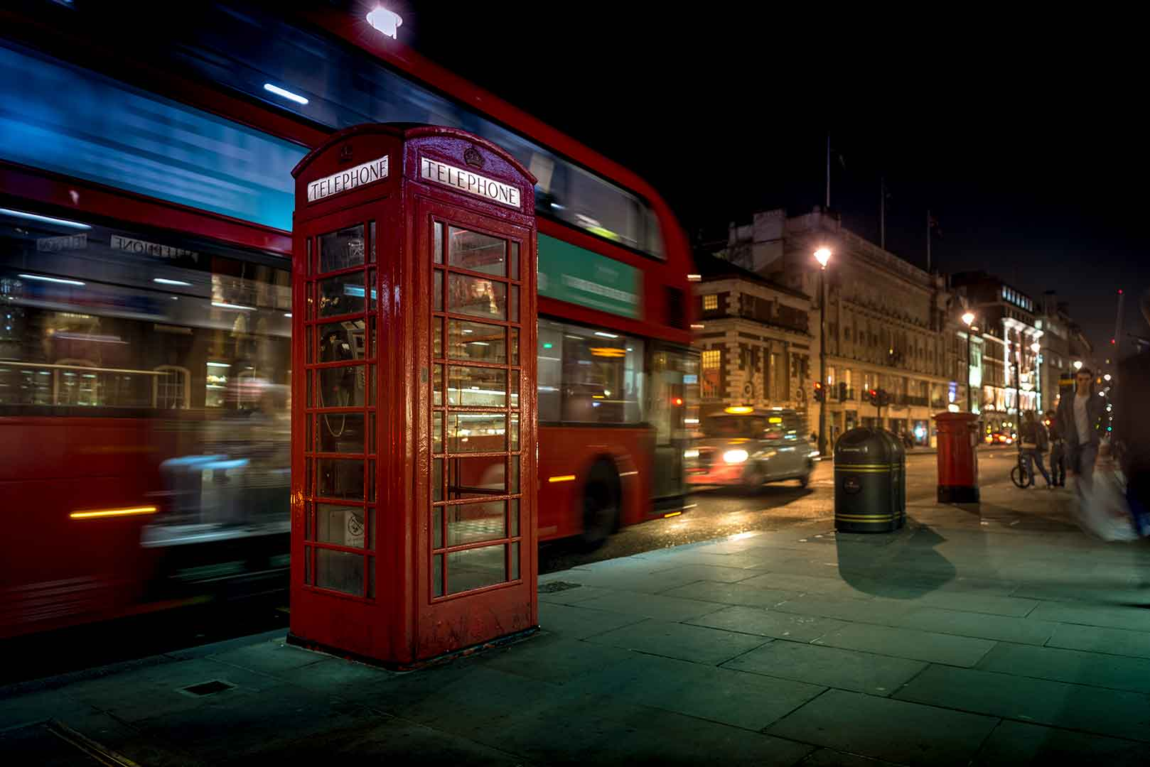 United Kingdom, London - Telephone booth and bus